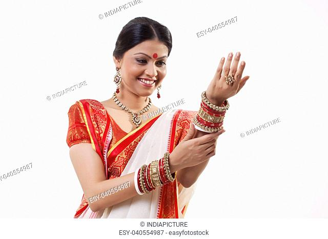 Bengali woman looking at her bangles