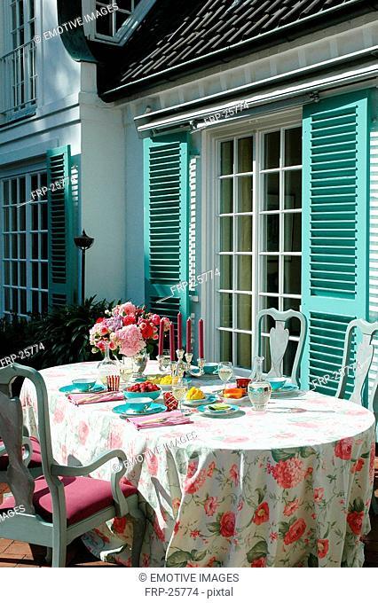 Laid table on terrace