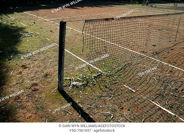 abandoned derelict tennis court