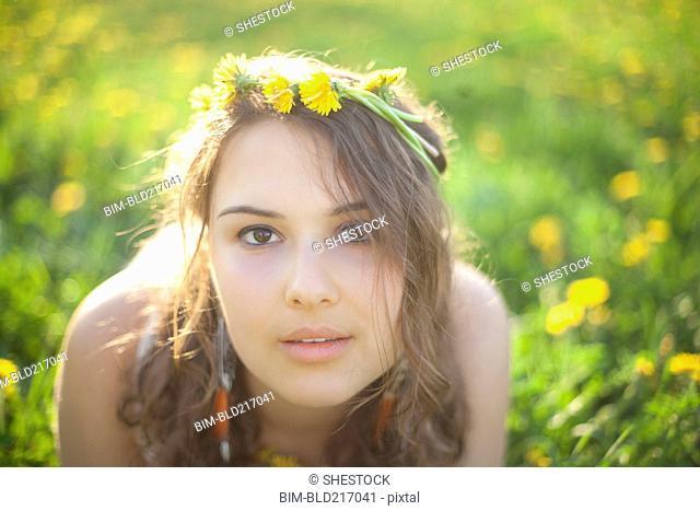 Caucasian woman wearing flowers in her hair