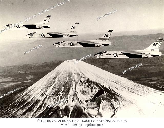 Four Vought F8U-1 Crusaders from VF-211 on USS Midway fly over Mount Fujiyama in Japan