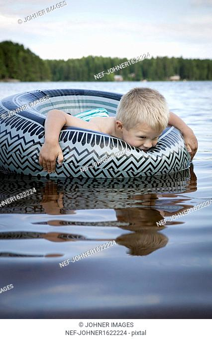 Boy swimming with inflatable ring