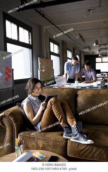 Creative businesswoman using digital tablet in office
