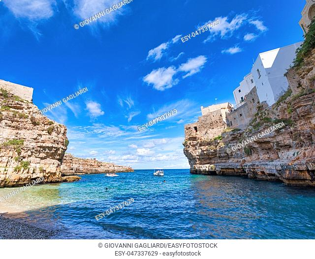 Amazing coastline of Polignano a Mare, Italy. Beach and beautiful summer sky
