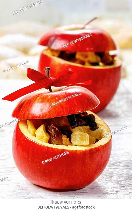 Red christmas apples stuffed with dried fruits in honey. Christmas decoration