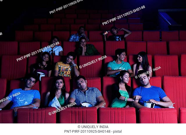 Youngsters enjoying movie in a cinema hall