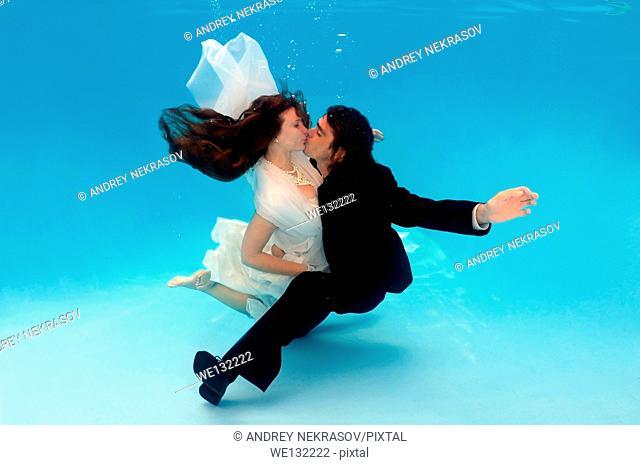 Underwater wedding in pool