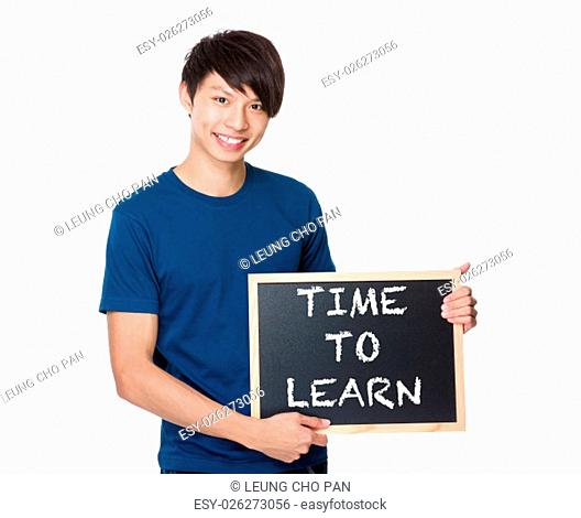 Asian man with the blackboard showing phrase of time to learn