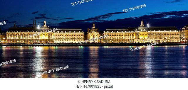 France, Nouvelle-Aquitaine, Bordeaux, Place de la Bourse across Garonne River at night