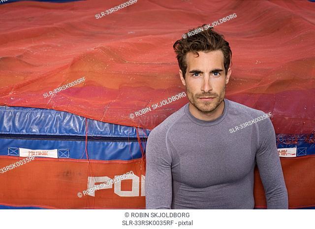 Runner sitting against mattress