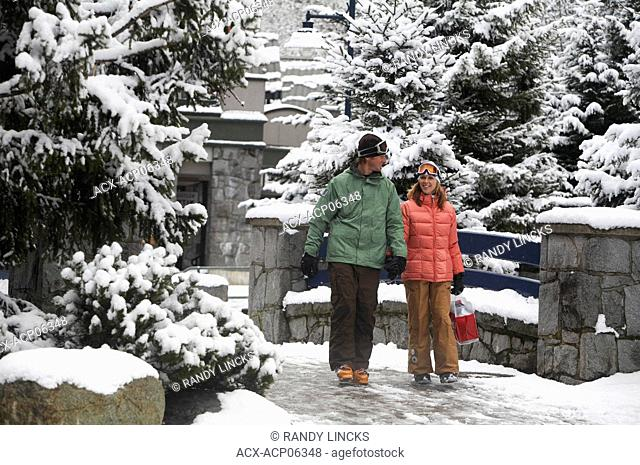 Young couple in Whistler Village, Whistler, British Columbia, Canada