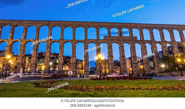 Partial view of the Roman aqueduct located in the city of Segovia at night , Unesco World Heritage Site, Spain