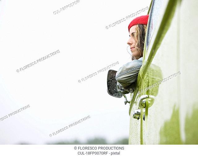 Woman looking out camper van