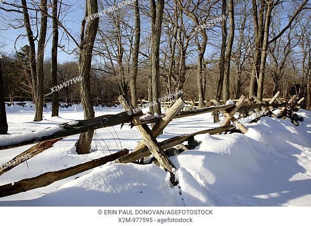 Minute Man National Historical Park   Wooden fence along the Battle Road Trail near Hartwell Tavern during the winter months  Located in Lincoln
