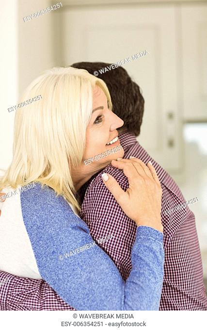 Happy mature couple hugging each other