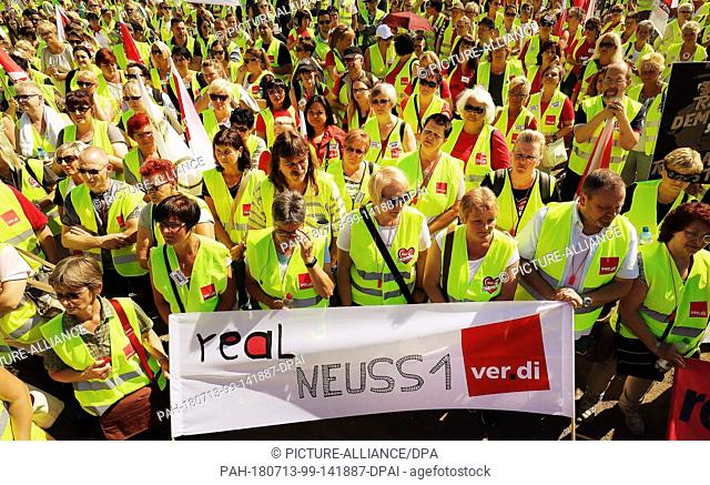 13 July 2018, Germany, Dusseldorf: Workers from the supermarket chain Real demonstrating in Dusseldorf. The Union Verdi called for the 34