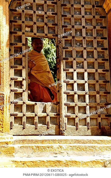 Hindu monk at doorway of a temple, Jaisalmer Fort, Jaisalmer, Rajasthan, India