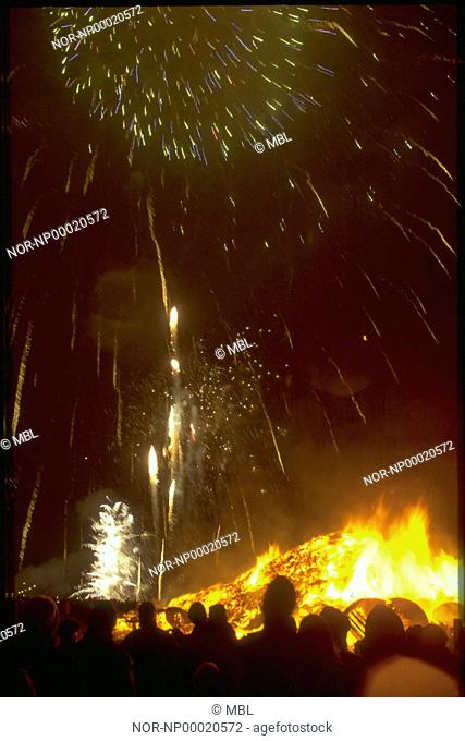 A New YearÂ's Eve in Iceland, peoble watching a bonfire