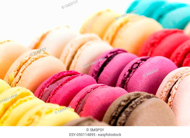 Close-up colored macaroons isolated on white, shallow dof
