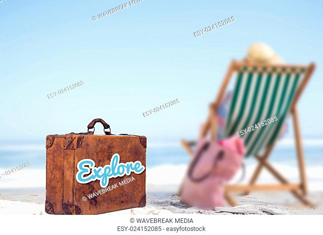 Composite image of explore message on a old suitcase