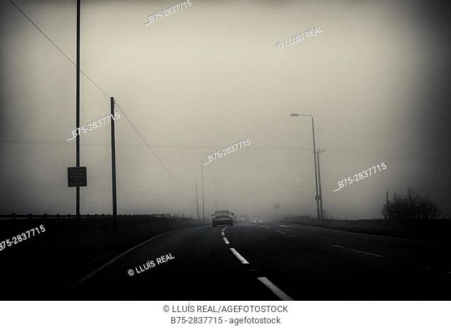 Road to Leeds-Bradford Airport (A658) in a foggy morning. England, UK