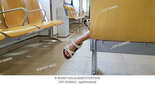 Feet of restless girl in the medical consultation