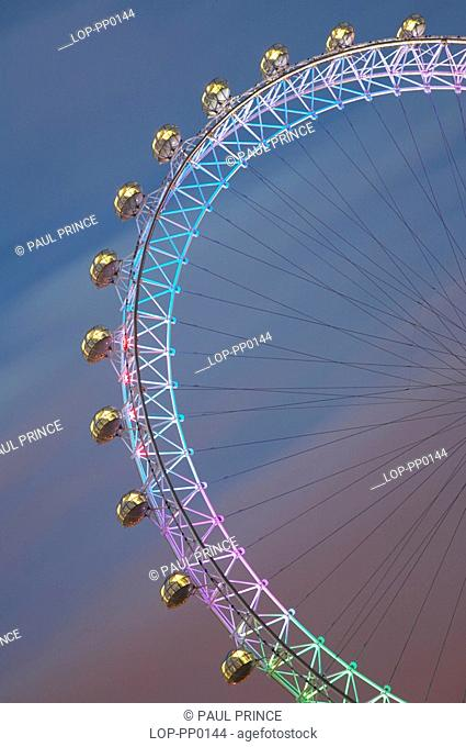 England, London, London Eye, The London Eye in Gay Pride lighting. The London Eye can carry 800 passengers per revolution - equivalent to 11 London red...