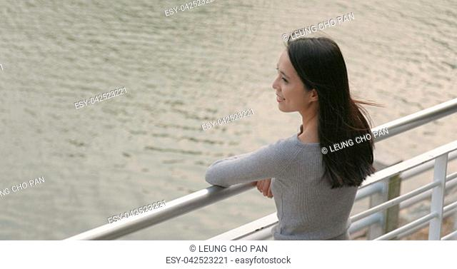 Woman enjoy the view at lakeside