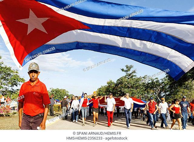 Cuba, Villa Clara, Santa Clara, Huge Cuban flag carried by supporters