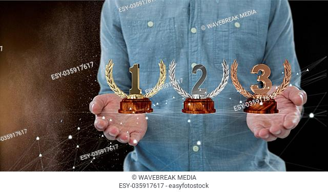 Man with trophies on hands
