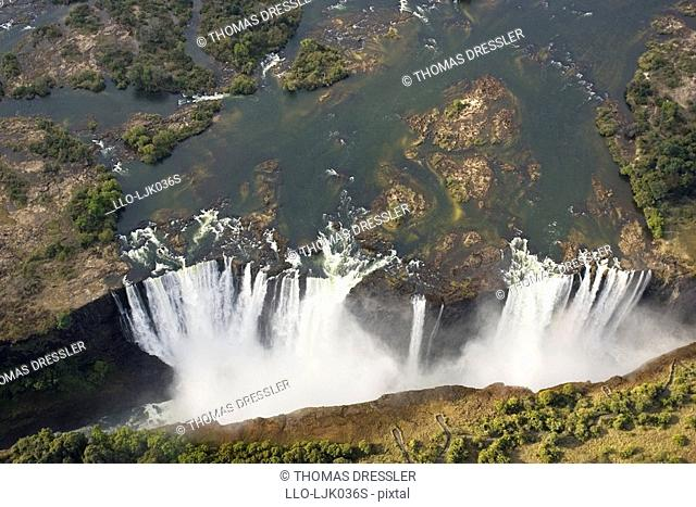Aerial view of Zambezi River and the Victoria Falls on the border of Zimbabwe and Zambia