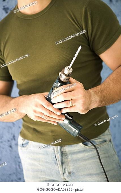 Man holding power drill