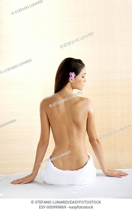 Rear view of a beautiful woman at spa
