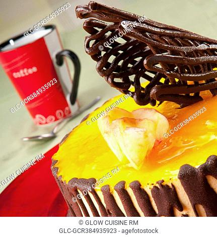 Close-up of chocolate garnish on lemon flan cake