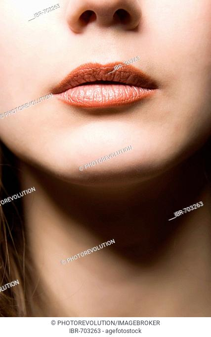 A young woman's lips and neck