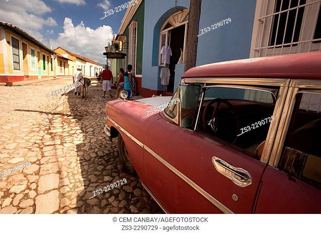 Old american car parked at the street side in front of La Bodeguita del Medio Bar, Trinidad, Santi Spiritus, Cuba, West Indies, Central America