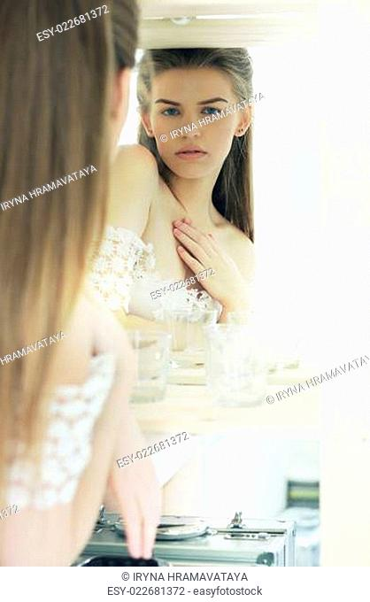 Expression. Candid Genuine Pensive Woman Reflects in Mirror