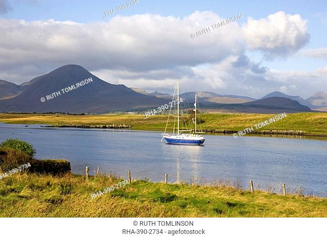 Yacht moored in inlet at Lower Breakish, near Broadford, Isle of Skye, Highland, Scotland, United Kingdom, Europe