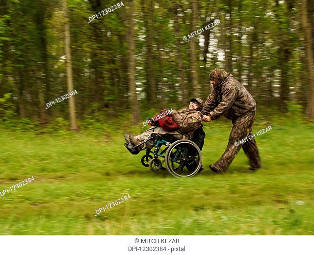 Wheelchair Bound Hunter With Turkey After Successful Hunt