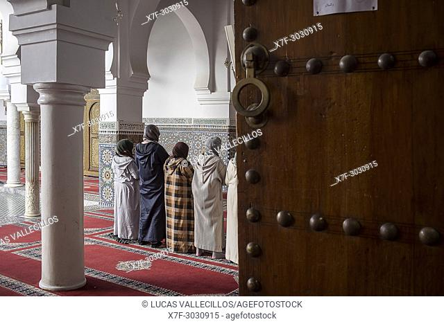 Women praying, Courtyard, Zaouia (tomb) of Moulay Idriss II, medina, Fez. Morocco