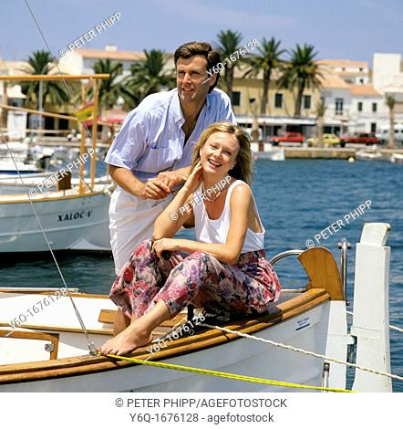 Holiday Couple at Fornells Harbour MInorca Spain