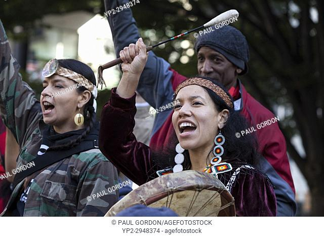 Seattle, Washington: Miriam Zmiewski (bottom right) drums at the Indigenous Peoples' Day March and Celebration at Westlake Park