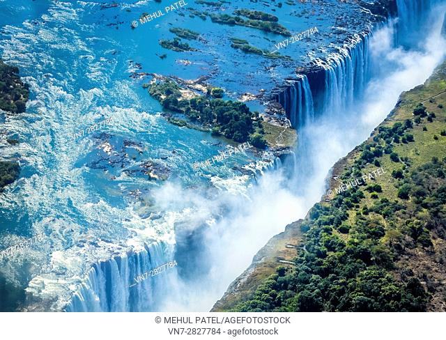 Aerial shot looking over Victoria Falls, the natural border of countries Zambia and Zimbabwe, Africa