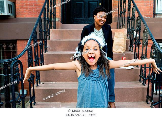 Girl smiling at camera with outstretched arms