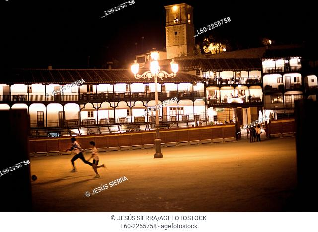 Boys plays soccer in the main square of Chinchón