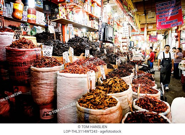 Mexico, Federal District, Mexico City. A stall specialising in dried chillies at the Mercado de la Merced in Mexico City