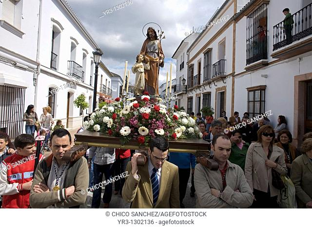 A sculpture of San Jose Joseph is carried during a religious procession the day before Holy Week begins in the town of Prado del Rey in southern Spain's Cadiz...