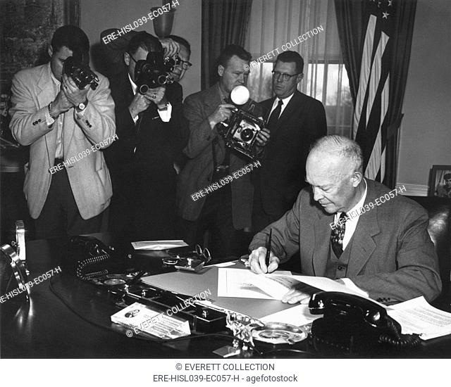 President Eisenhower signing a Resolution to Promote Peace and Stability in the Middle East. It stated the United States is prepared to use armed force to...