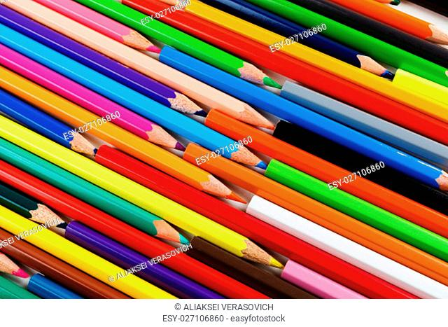 Bright color pencils lying on a flat surface. Colored pencils as background