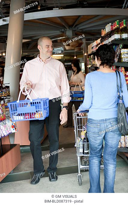 Hispanic people shopping in grocery store